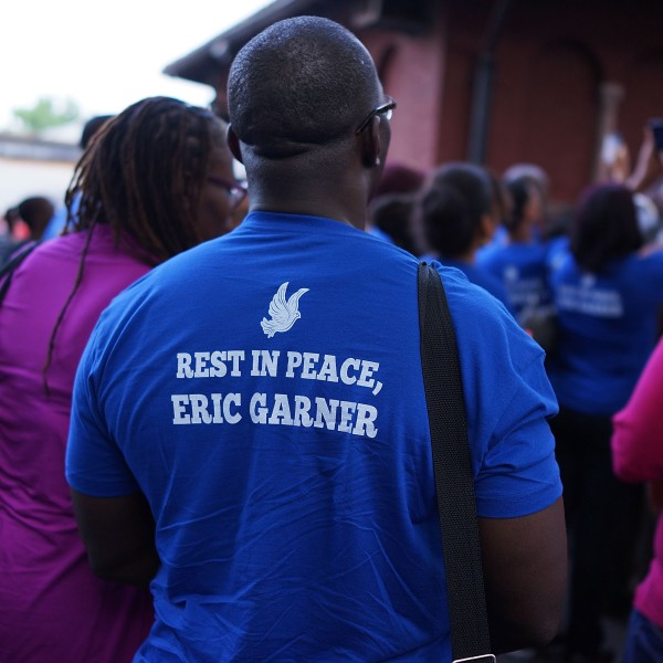People attend a vigil for Eric Garner near where he died after he was taken into police custody in Staten Island last Thursday on July 22, 2014, in New York City. (Credit: Spencer Platt/Getty Images)