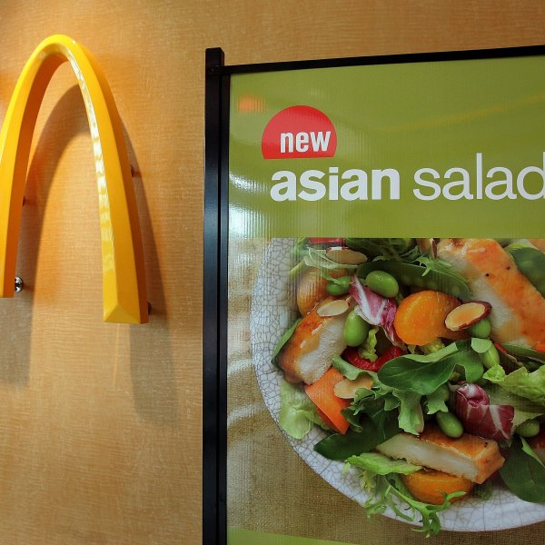 "A display for McDonald's Asian Salad, part a their new ""Go Active Happy Meal,"" is visible next to a McDonald's logo April 25, 2006, in a McDonald's restaurant in Oakbrook, Illinois. (Credit: Tim Boyle/Getty Images)"