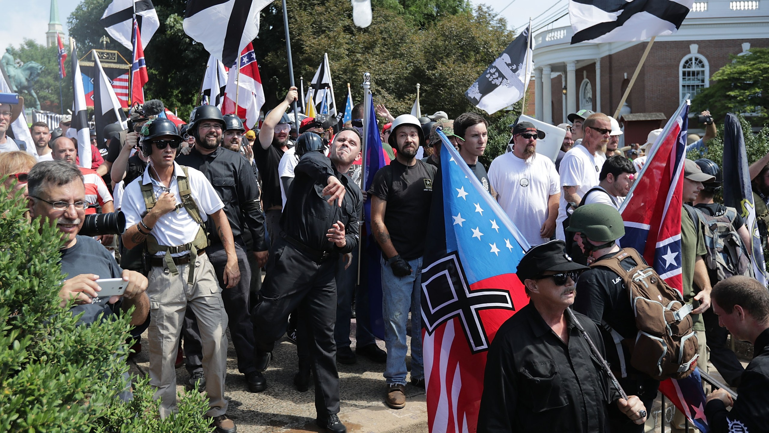 "Hundreds of white nationalists, neo-Nazis, KKK and members of the ""alt-right"" hurl water bottles back and forth against counter demonstrators on the outskirts of Emancipation Park during the Unite the Right rally on Aug. 12, 2017 in Charlottesville, Virginia. (Credit: Chip Somodevilla/Getty Images)"