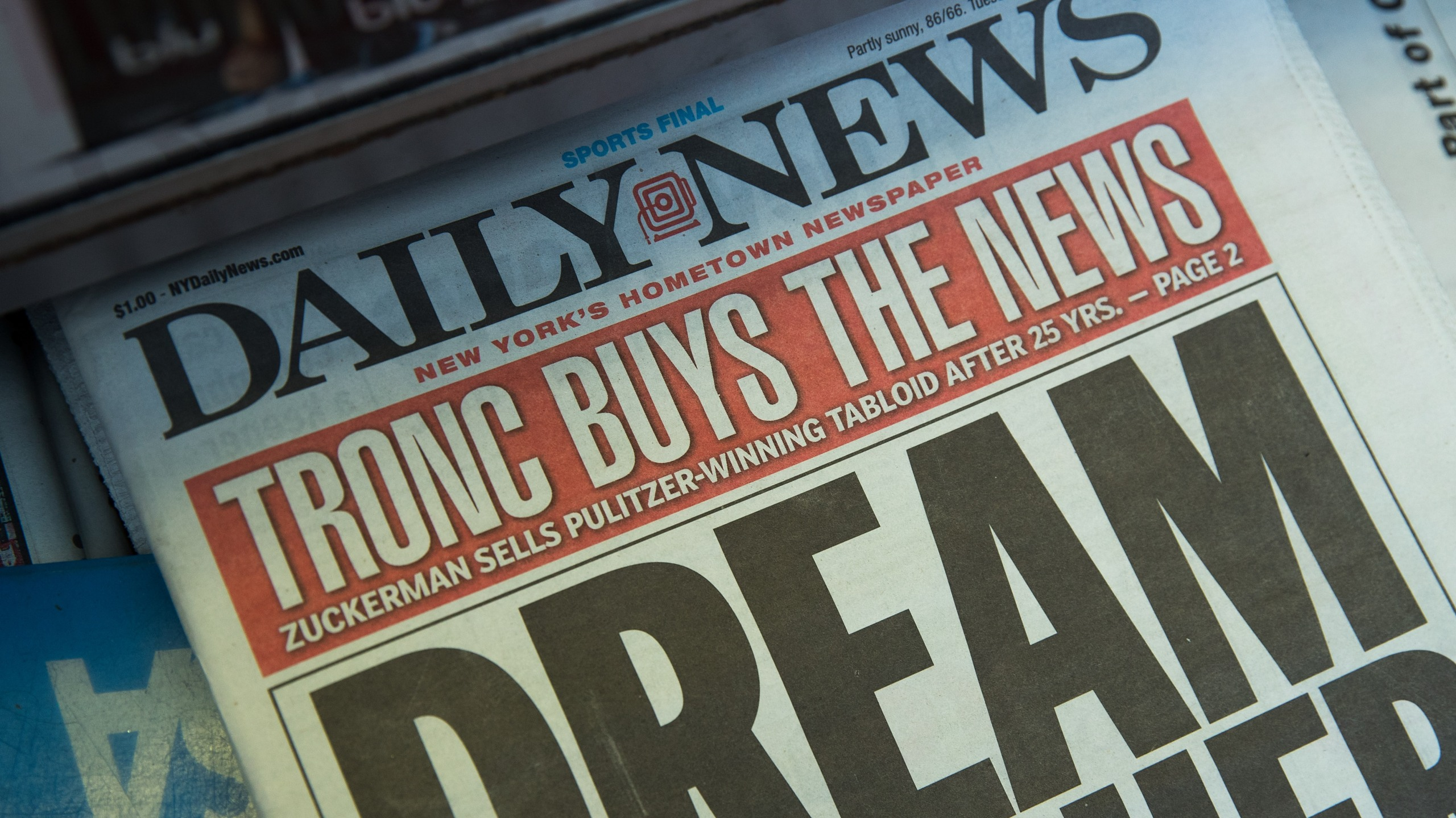 A copy of the New York Daily News sits on the shelf of a newsstand on Sept. 5, 2017 in New York City. Tronc, the publisher of the Chicago Tribune and The Los Angeles Times newspapers, announced on Monday that is had purchased The New York Daily News. (Credit: Drew Angerer/Getty Images)