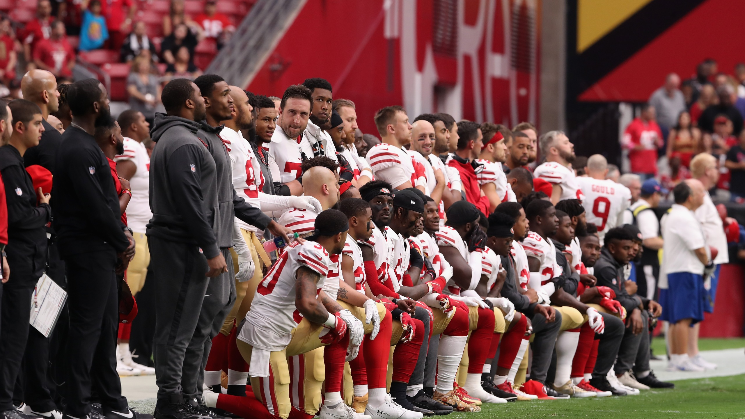 Members of the San Francisco 49ers kneel for the National Anthem before the start of the NFL game against the Arizona Cardinals at the University of Phoenix Stadium on Oct. 1, 2017 in Glendale, Arizona. (Credit: Christian Petersen/Getty Images)