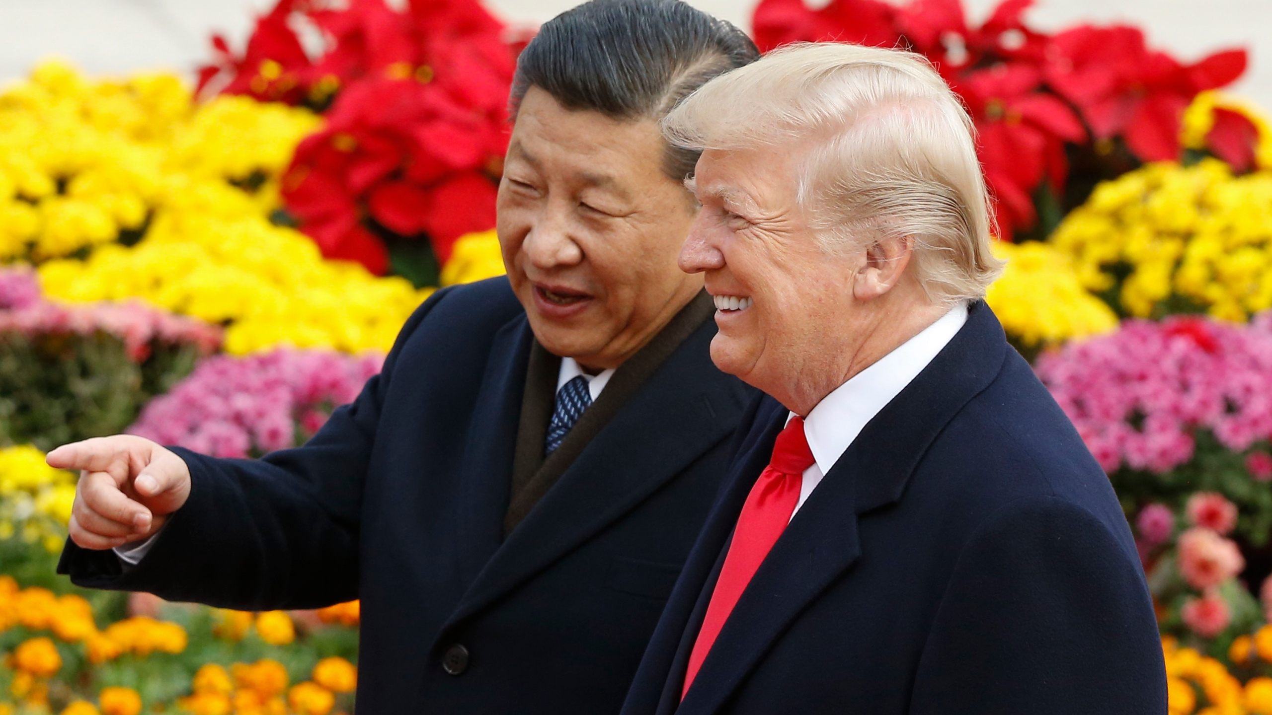 Chinese President Xi Jinping and President Donald Trump attend a welcoming ceremony Nov. 9, 2017, in Beijing, China. (Credit: Thomas Peter / Getty Images)