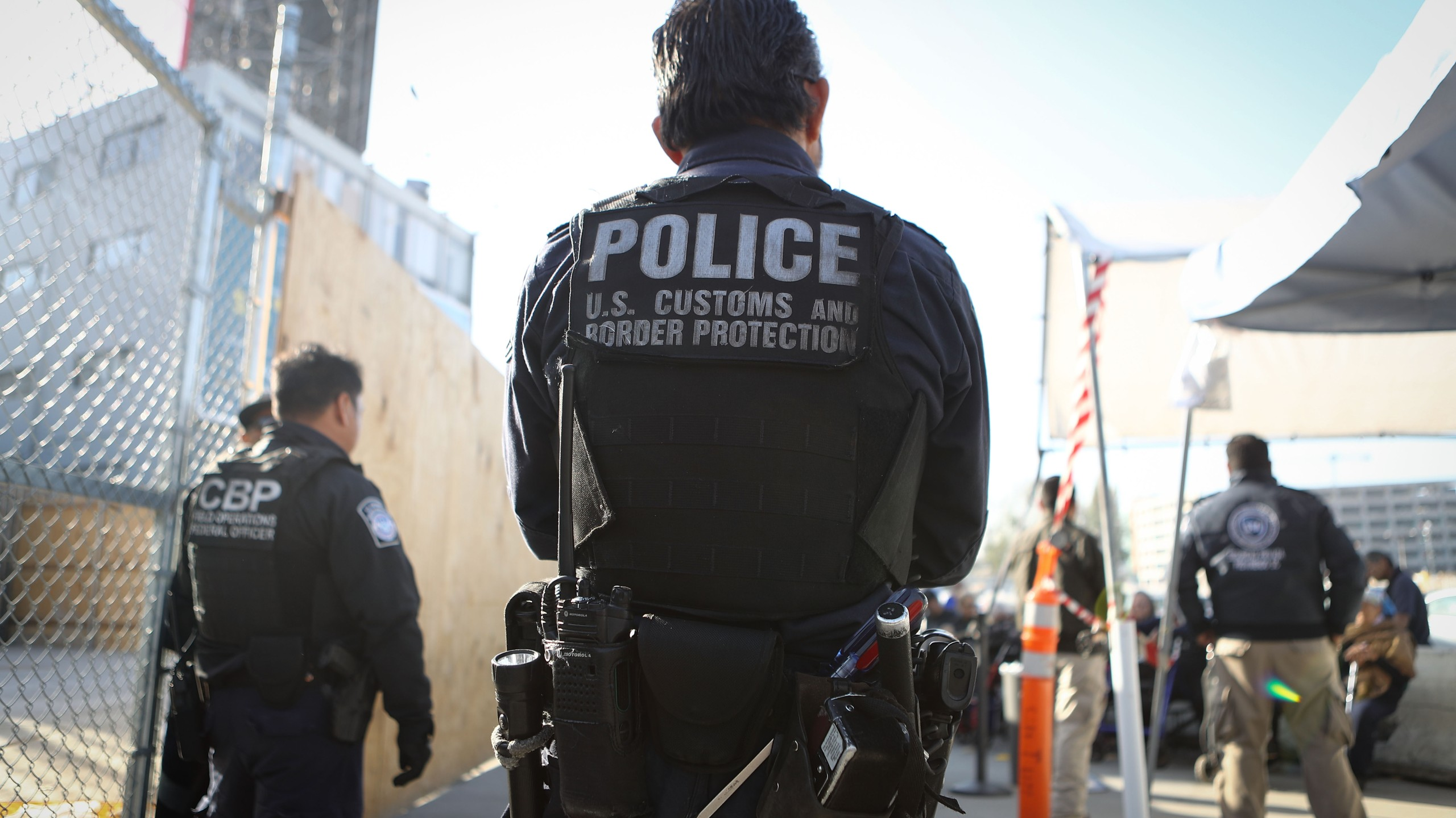 A U.S. Customs and Border Protection officer waits for pedestrians entering the United States at the San Ysidro port of entry on April 9, 2018. (Credit: Mario Tama/Getty Images)