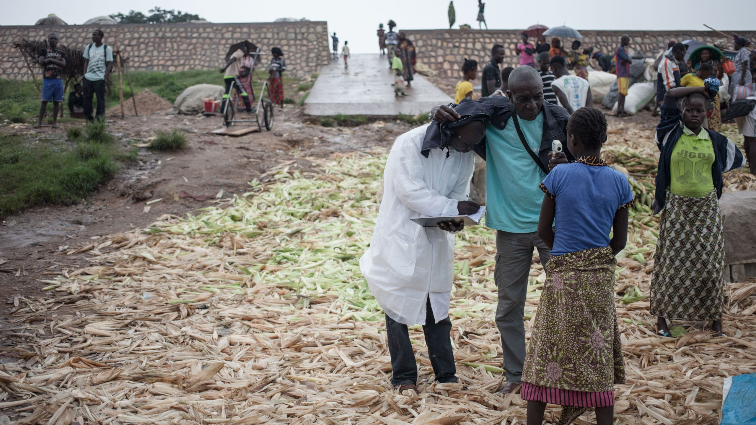 Health workers from the Ministry of Health monitor the temperature of a traveller from the Democratic Republic of Congo at each port in Bangui on June 3, 2018. (Credit: Florent Vergnes/AFP/Getty Images)