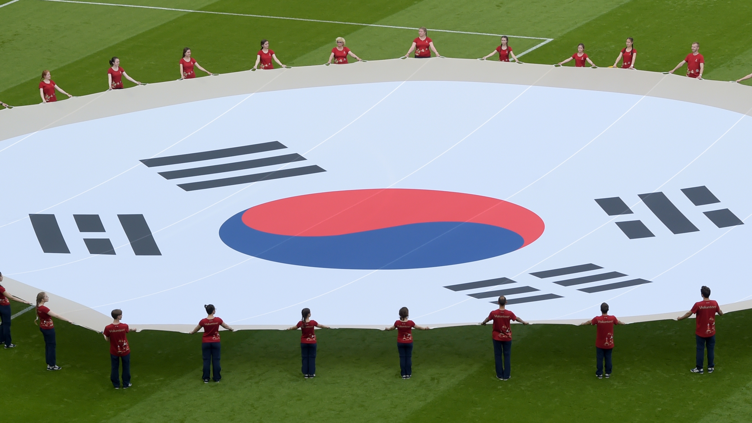 South Korea's flag is waved ahead of the Russia 2018 World Cup Group F football match between South Korea and Germany at the Kazan Arena in Kazan on June 27, 2018. (Credit: Luis Acosta/AFP)
