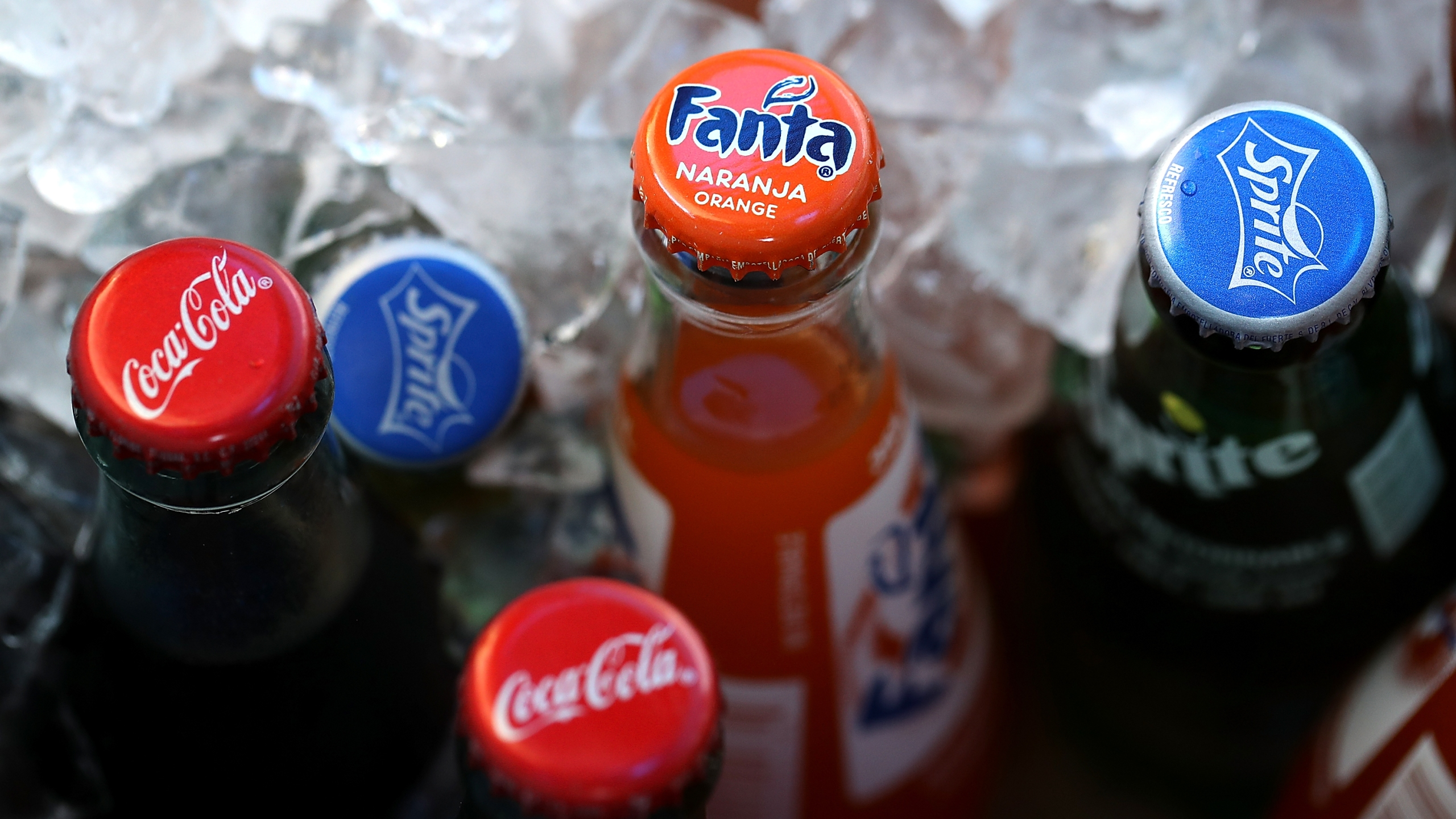 Bottles of soda are displayed in a cooler in San Francisco on June 29, 2018. (Credit: Justin Sullivan / Getty Images)