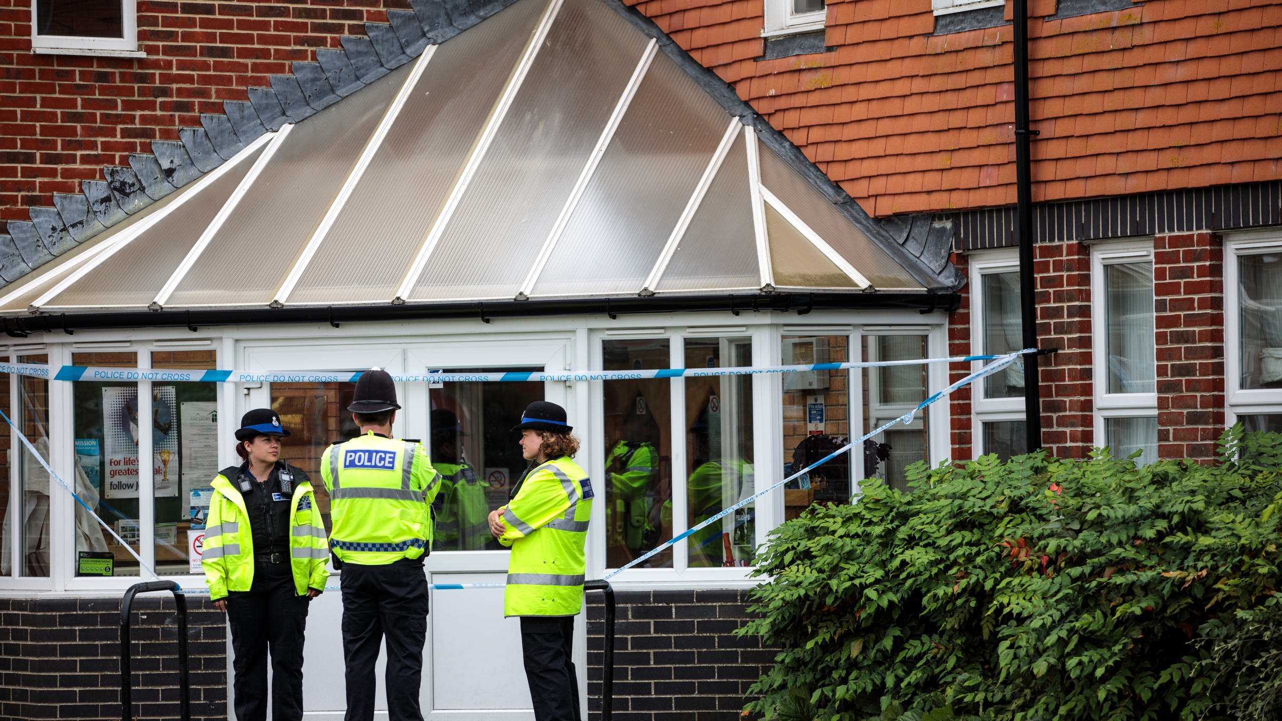 Officials convene at the scene outside Amesbury Baptist Centre as Wiltshire Police declare a major incident after a man and woman were exposed to an unknown substance on July 4, 2018, in Amesbury, England. (Credit: Jack Taylor / Getty Images)