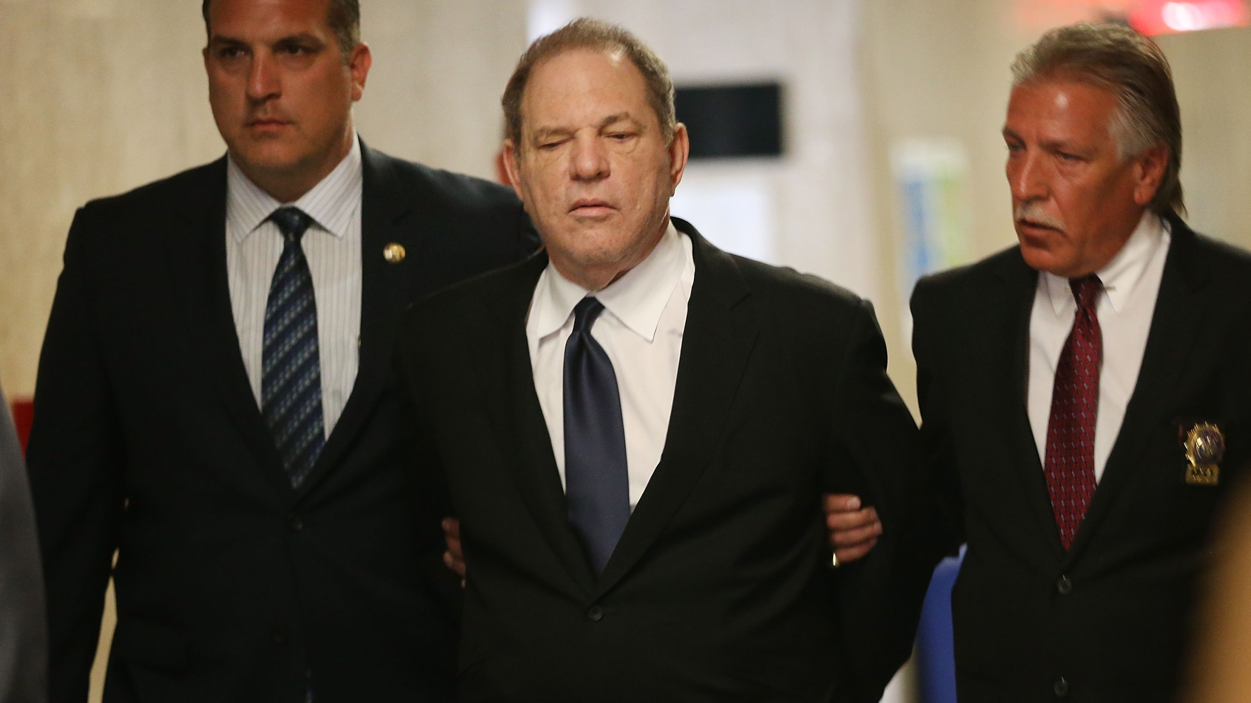 Harvey Weinstein is escorted in handcuffs into State Supreme Court on July 9, 2018 for arraignment on charges alleging he committed a sex crime against a third woman. (Credit: Spencer Platt/Getty Images)