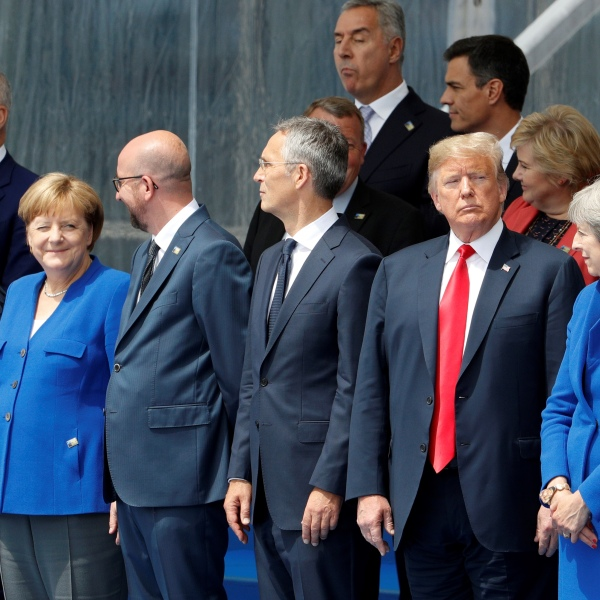 Lithuania's President Dalia Grybauskaite, German Chancellor Angela Merkel, Belgium's Prime Minister Charles Michel, NATO Secretary General Jens Stoltenberg, U.S. President Donald Trump and Britain's Prime Minister Theresa May attend the opening ceremony of the North Atlantic Treaty Organization summit at the NATO headquarters in Brussels, on July 11, 2018. (Credit: GEOFFROY VAN DER HASSELT/AFP/Getty Images)