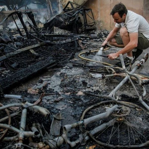 Eric Durtschi searches through the rubble for personal belongings after his rental home was destroyed by wildfire in Goleta in July 2018. (Credit: Marcus Yam / Los Angeles Times)