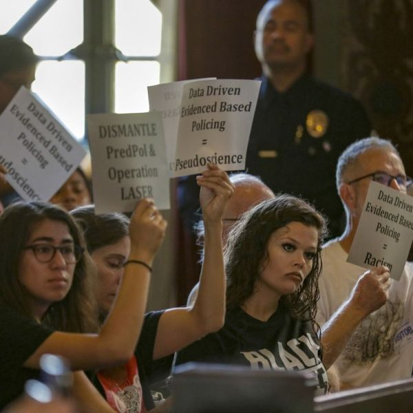 Protestors are seen at a July 24, 2018, meeting on the LAPD's use of data in policing, including predictive policing analysis that pinpoints crime hotspots. (Credit: Irfan Khan / Los Angeles Times)