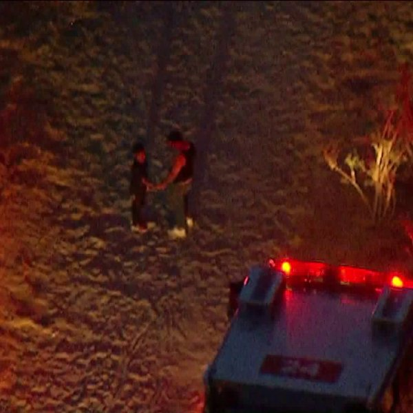 Authorities respond to the scene where a horse fell on and injured two children in Lake View Terrace on July 10, 2018. (Credit: KTLA)