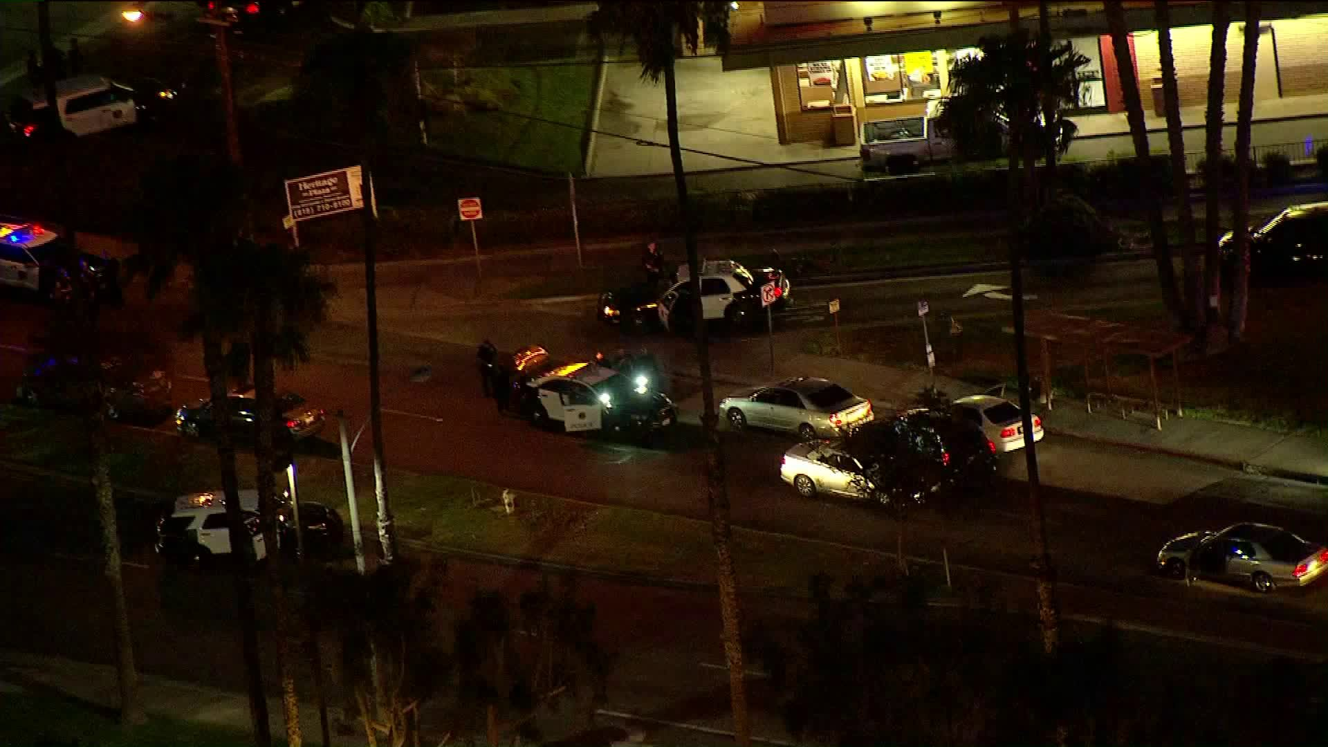 Authorities surround a vehicle in Riverside after a chase. (Credit: KTLA)