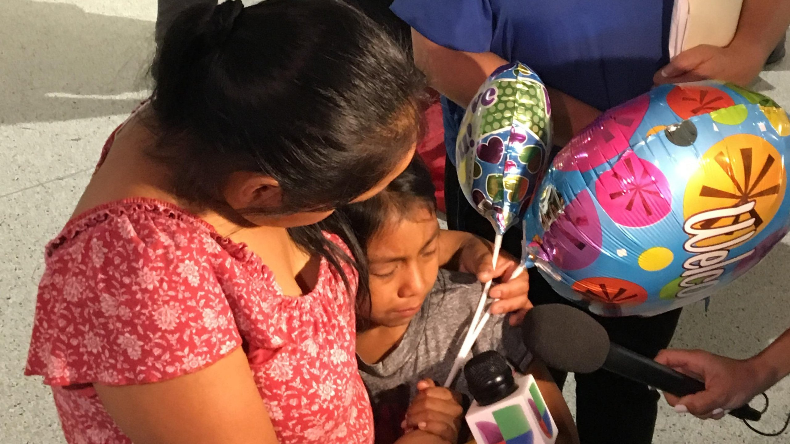 Buena Ventura Martin-Godinez and her 7-year-old daughter were reunited at Miami-Dade airport after being separated for nearly 2 months. (Credit: CNN)