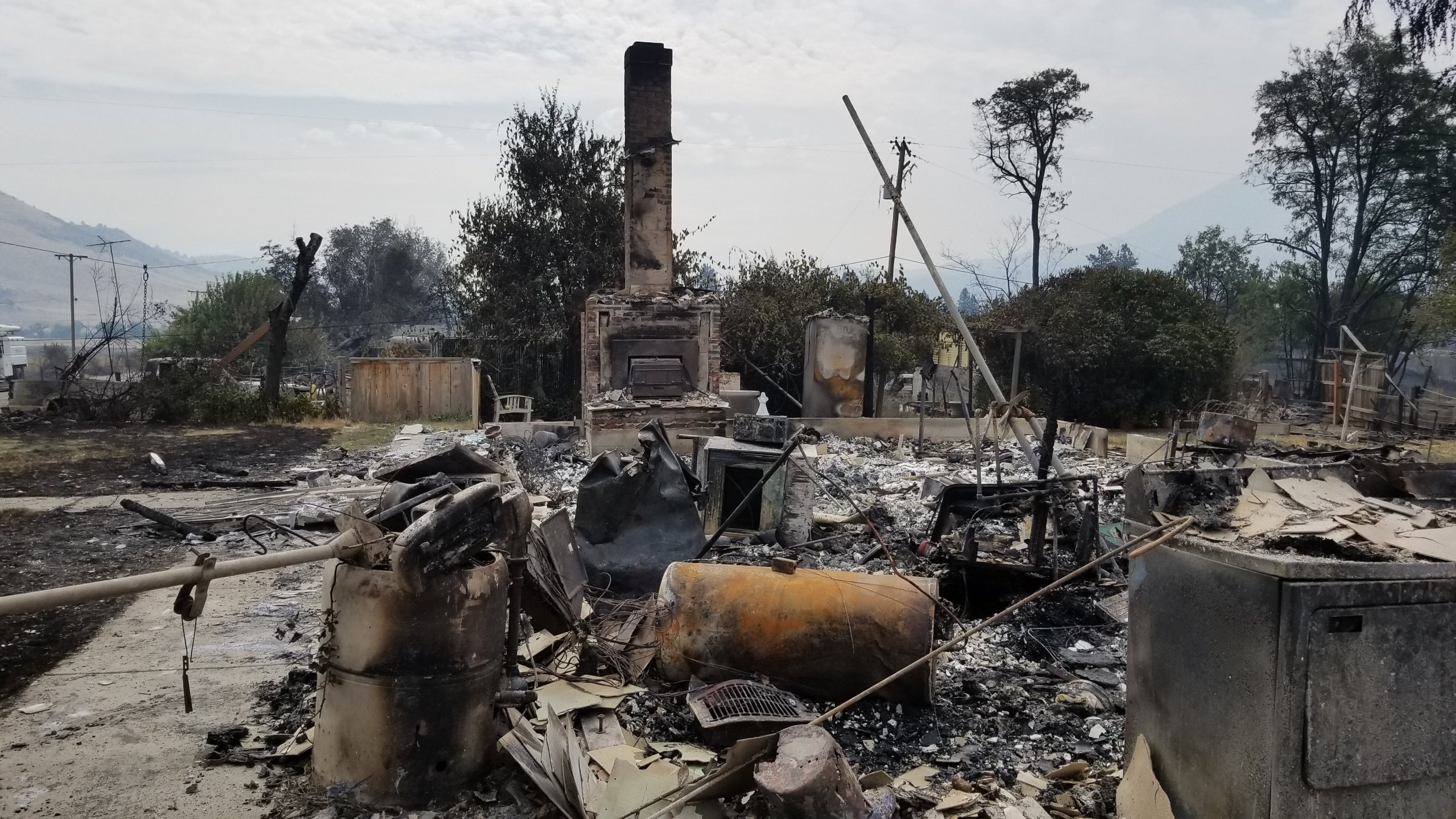 A photo shows the remnants of a home devoured by the Klamathon Fire in Hornbrook, Calif., on July 6, 2018. (Credit: Mario Montalvo/KHSL via CNN)