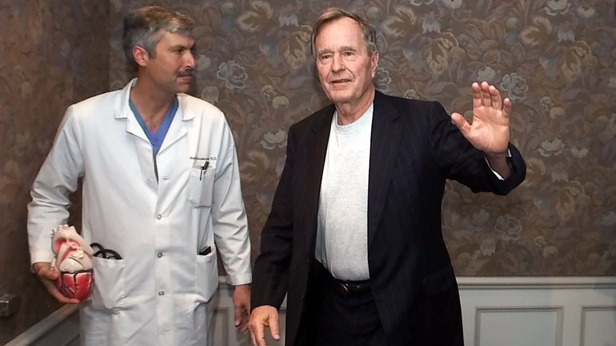 Former President George H.W. Bush, right, and Dr. Mark Hausknecht are seen after a news conference at Houston Methodist Hospital in 2000. (Credit: David J. Phillip / AP via CNN)