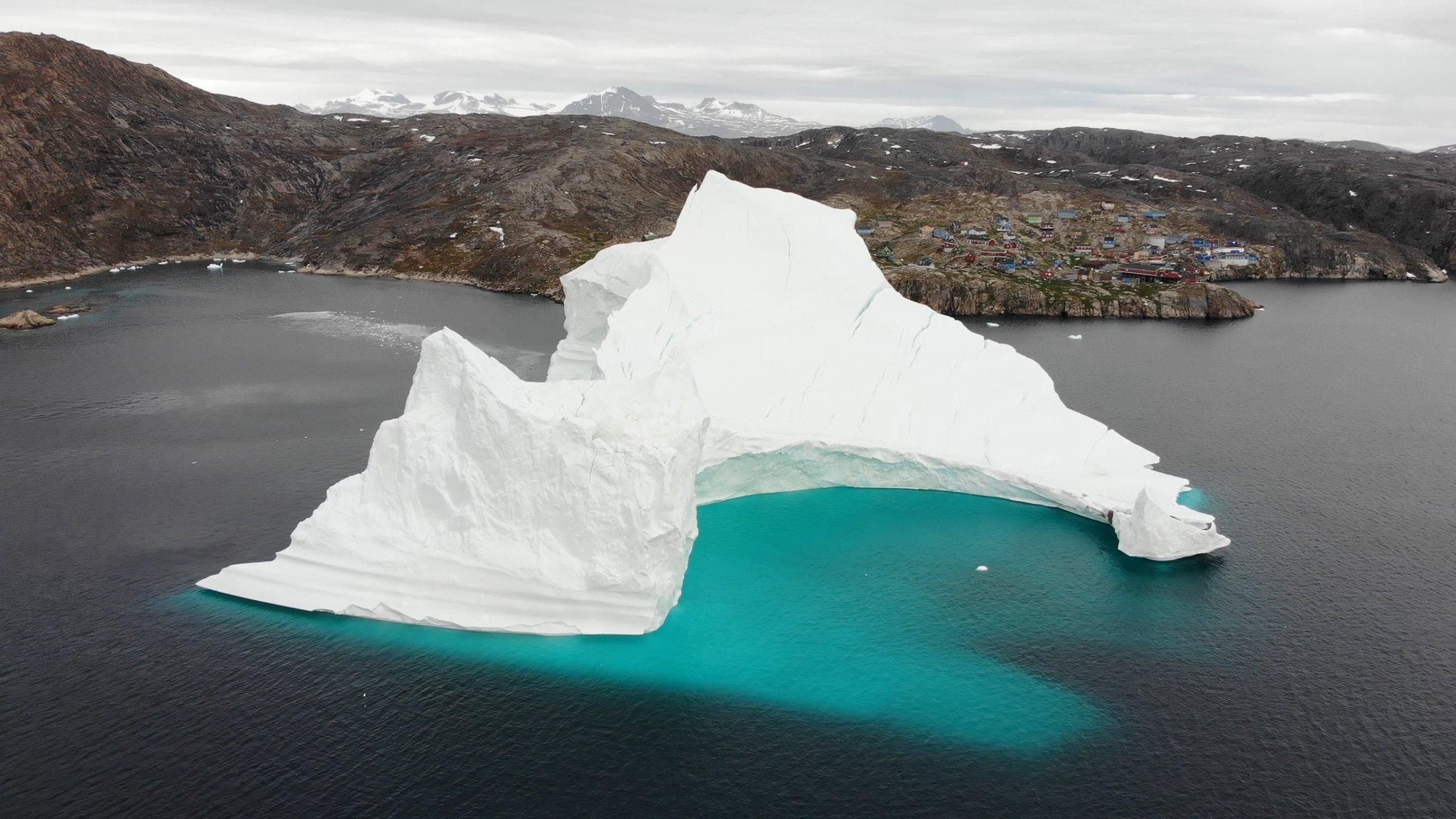 An 11-million-ton iceberg is threatening the isolated fishing village of Innaarsuit, Greenland. (Credit: CNN)