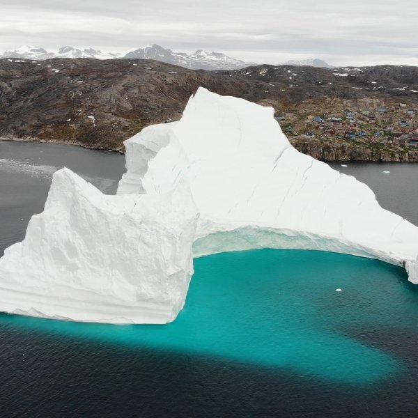 An 11-million-ton iceberg is threatening the isolated fishing village of Innaarsuit, Greenland. (Credit: CNN)