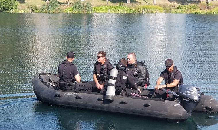 Divers search Echo Park Lake after a boat capsized on July 26, 2018. (Credit: Los Angeles Police Department)