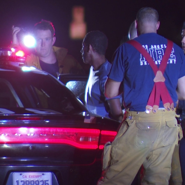A man is detained after two people were found with stab wounds in Sherman Oaks on July 24, 2018. (KTLA)