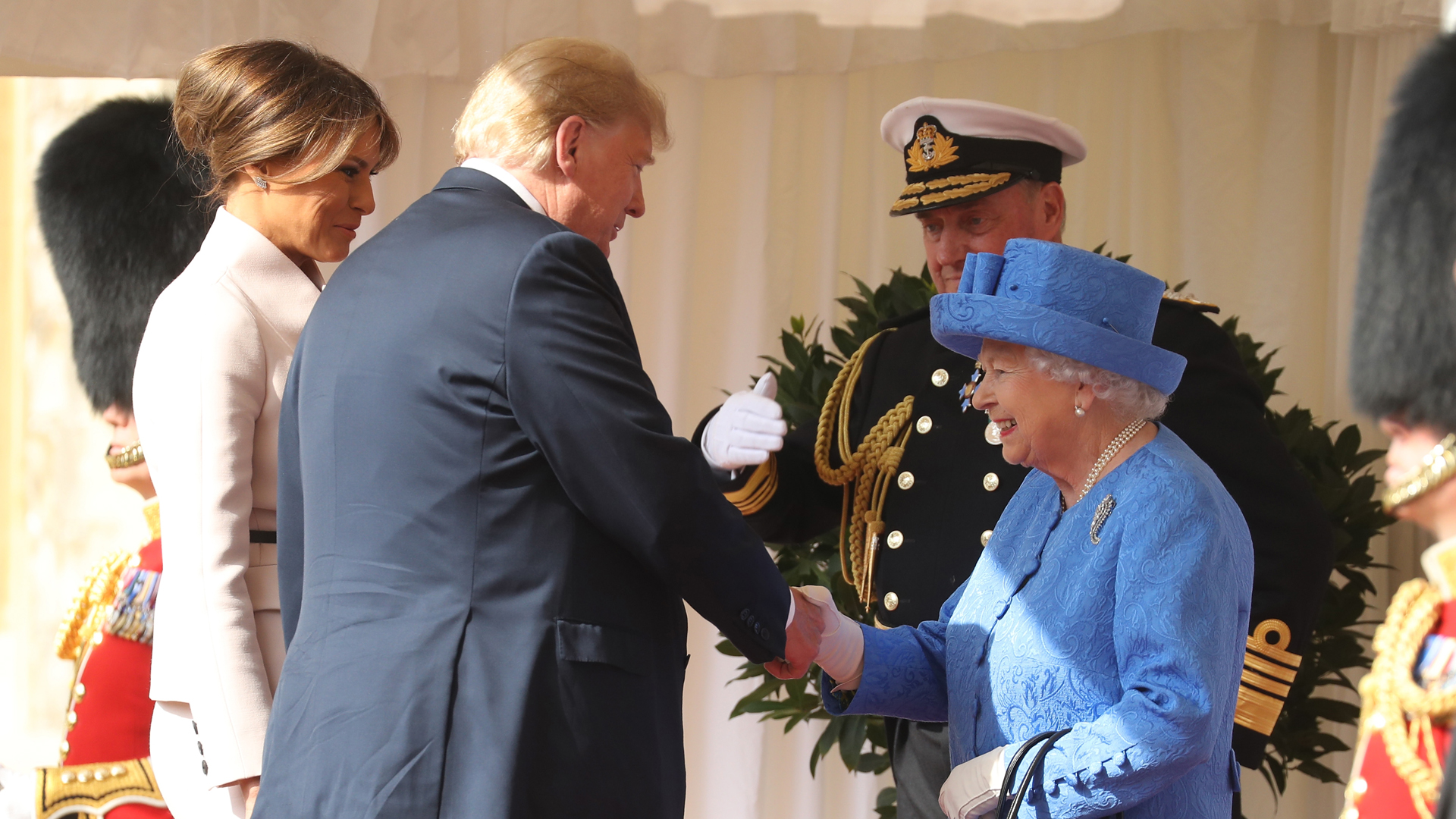 Britain's Queen Elizabeth II shakes hands with Donald Trump as he and US First Lady Melania Trump arrive for a welcome ceremony at Windsor Castle on July 13, 2018. (Credit: Chris Jackson / POOL / Getty Images)