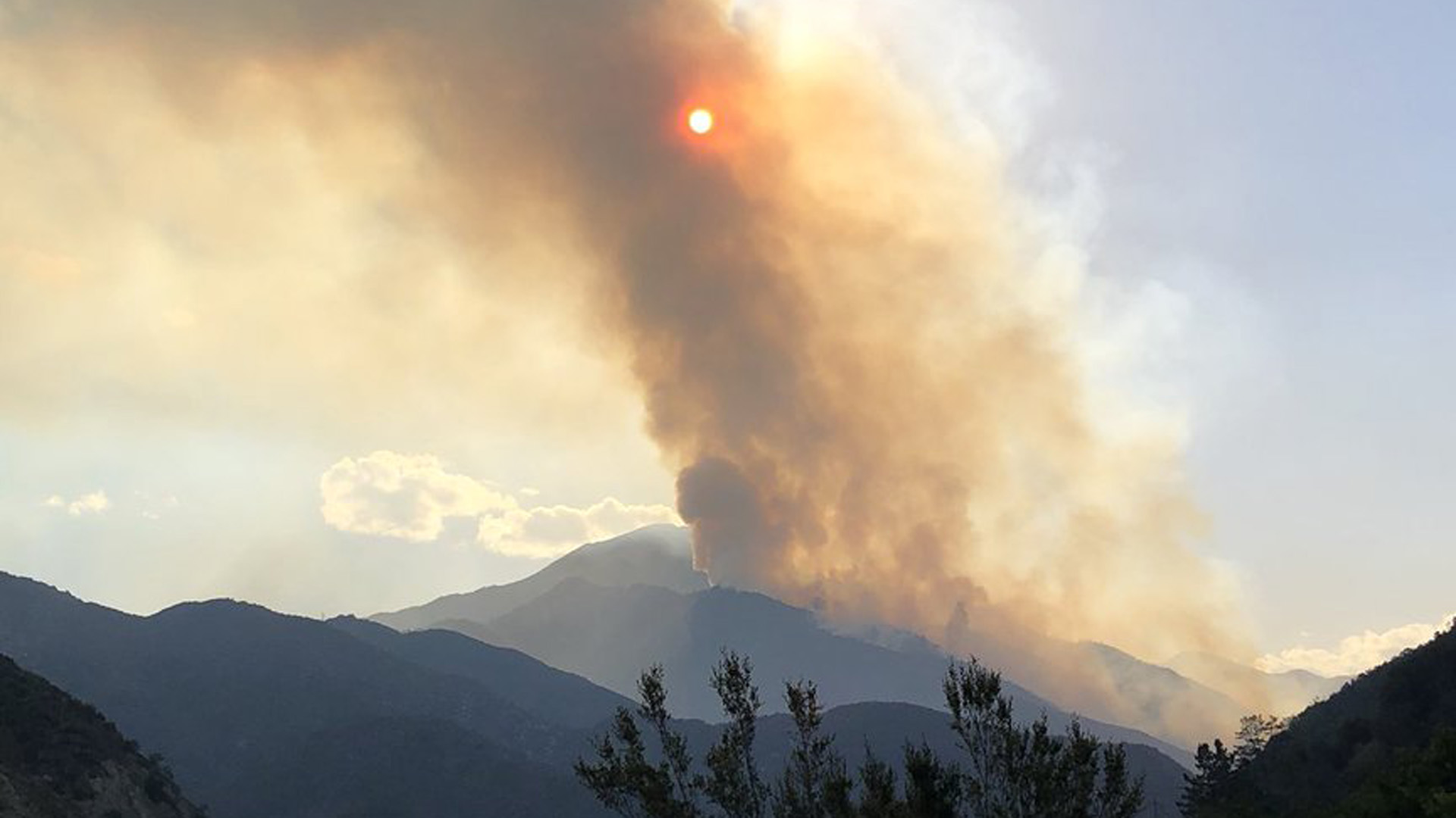 An image tweeted by Cal Fire on July 8, 2018 shows smoke from the Valley Fire in the mountains east of San Bernardino.