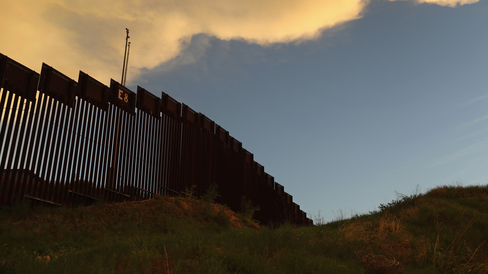 The fence marking the U.S.-Mexico border is seen at sunset on July 22, 2018 in Nogales, Arizona. (Credit: John Moore/Getty Images)