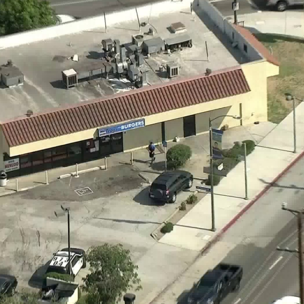 An image taken from Sky5 video shows a police vehicle in the parking lot of Troy's Burgers in El Sereno on Aug. 2, 2018. (Credit: KTLA)