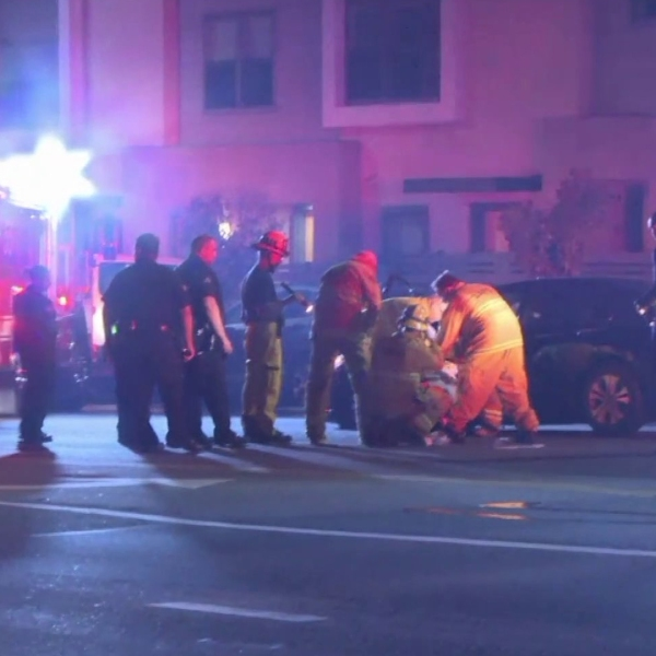 First responders tend to a victim at a reported road rage incident and crash in Glassell Park on Aug, 19, 2018. (Credit: Loudlabs)