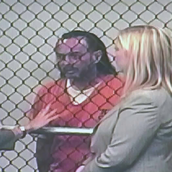 Forrest Gordon Clark, flanked by two attorneys, appears in a Santa Ana courthouse for the first time on Aug. 10, 2018. (Credit: KTLA)