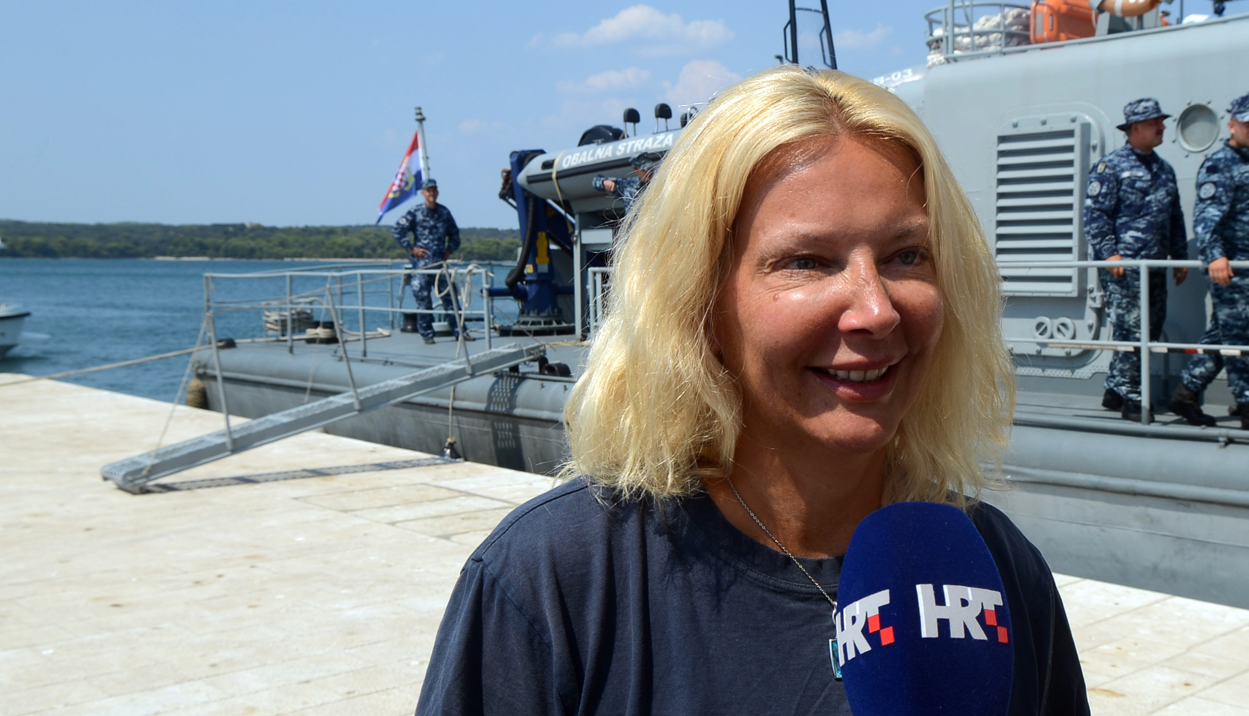 British tourist Kay Longstaff speaks to the press upon her arrival in Pula with the Croatias coast guard ship, on August 19, 2018, which saved her after falling off a cruise ship near Croatian coast. (Credit: STR/AFP/Getty Images).