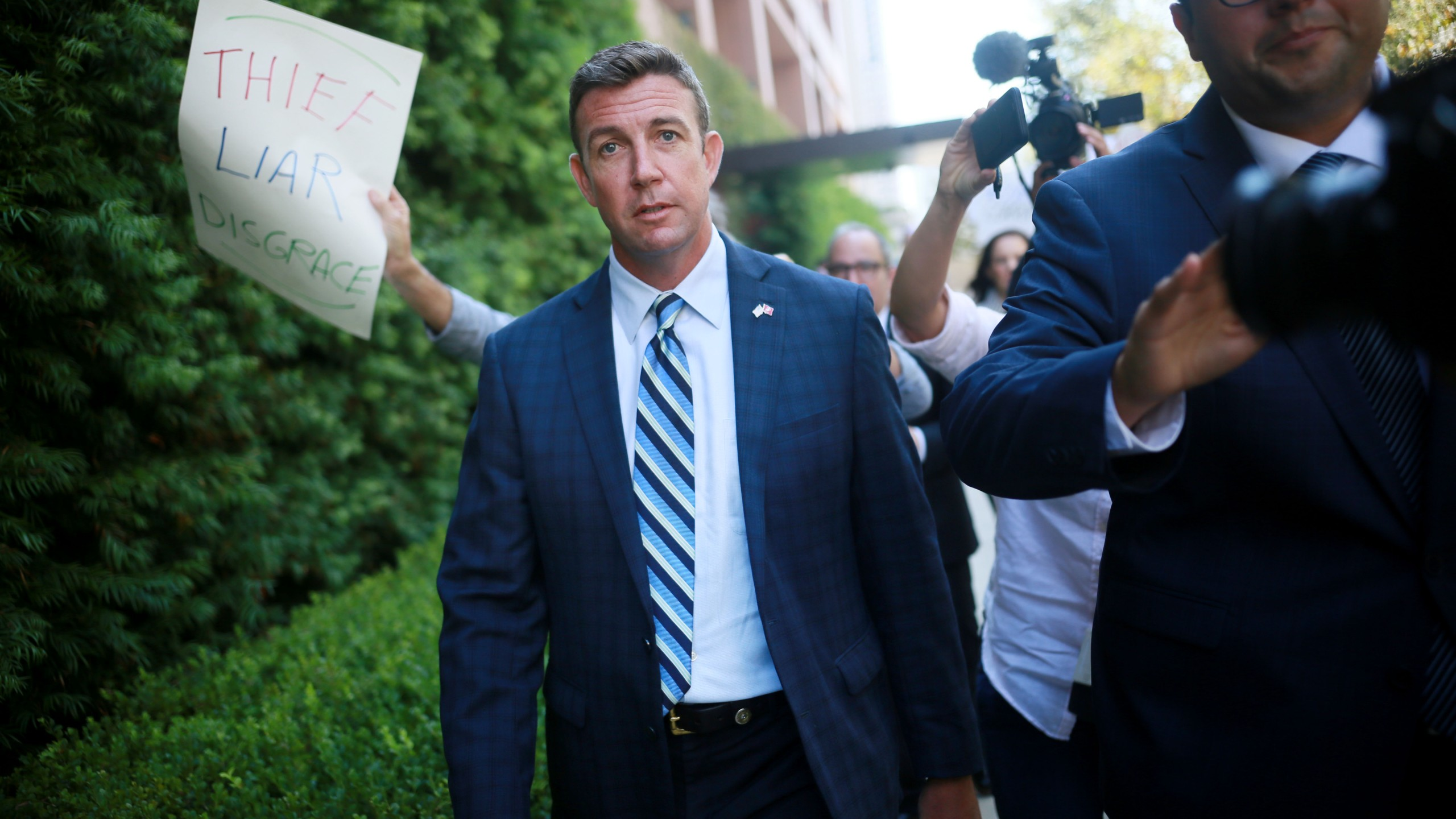 Congressman Duncan Hunter walks out of the San Diego Federal Courthouse after an arraignment hearing on Aug. 23, 2018. (Credit: Sandy Huffaker / Getty Images)