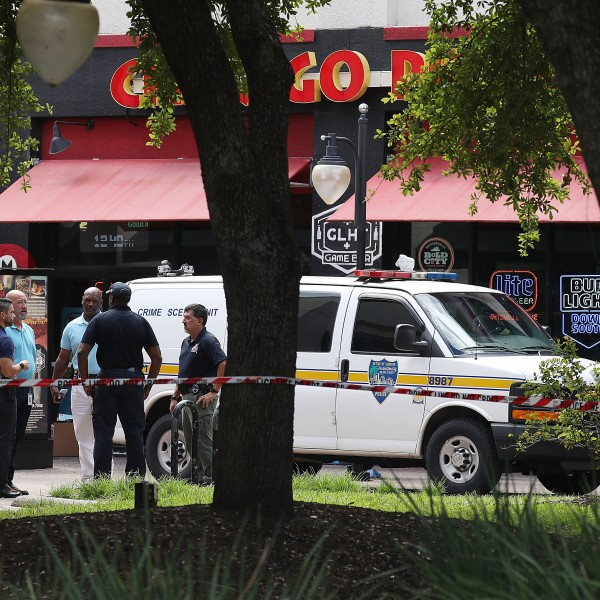 Law enforcement officials investigate a shooting in the GLHF Game Bar where 3 people including the gunman were killed at the on Aug. 27, 2018 in Jacksonville. (Credit: Joe Raedle/Getty Images)