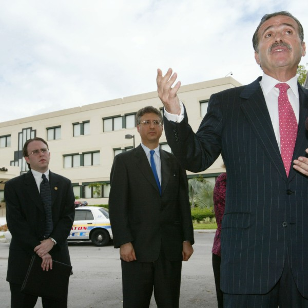 David Pecker, the CEO of American Media, speaks to the news media August 16, 2002, in front of the American Media Building in Boca Raton, Fla. (Credit: Joe Raedle/ Getty Images)