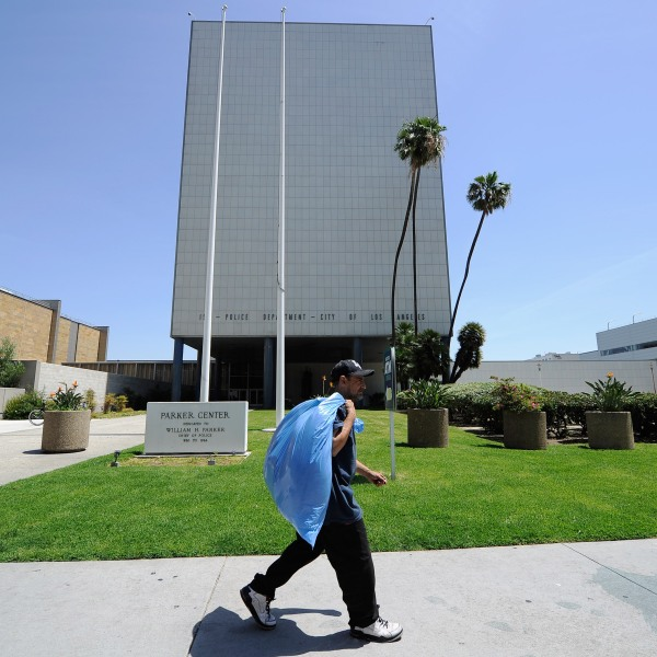 A man walks past the now empty Los Angeles Police Department headquarters, Parker Center, which was one of the flash points of the 1992 L.A. riots, on April 28, 2012. (Credit: Kevork Djansezian / Getty Images)