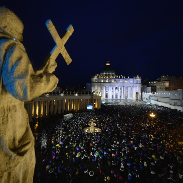 Pilgrims gather in St. Peter's Square on day two of the conclave on March 13, 2013, in Vatican City. (Credit: Jeff J. Mitchell / Getty Images)