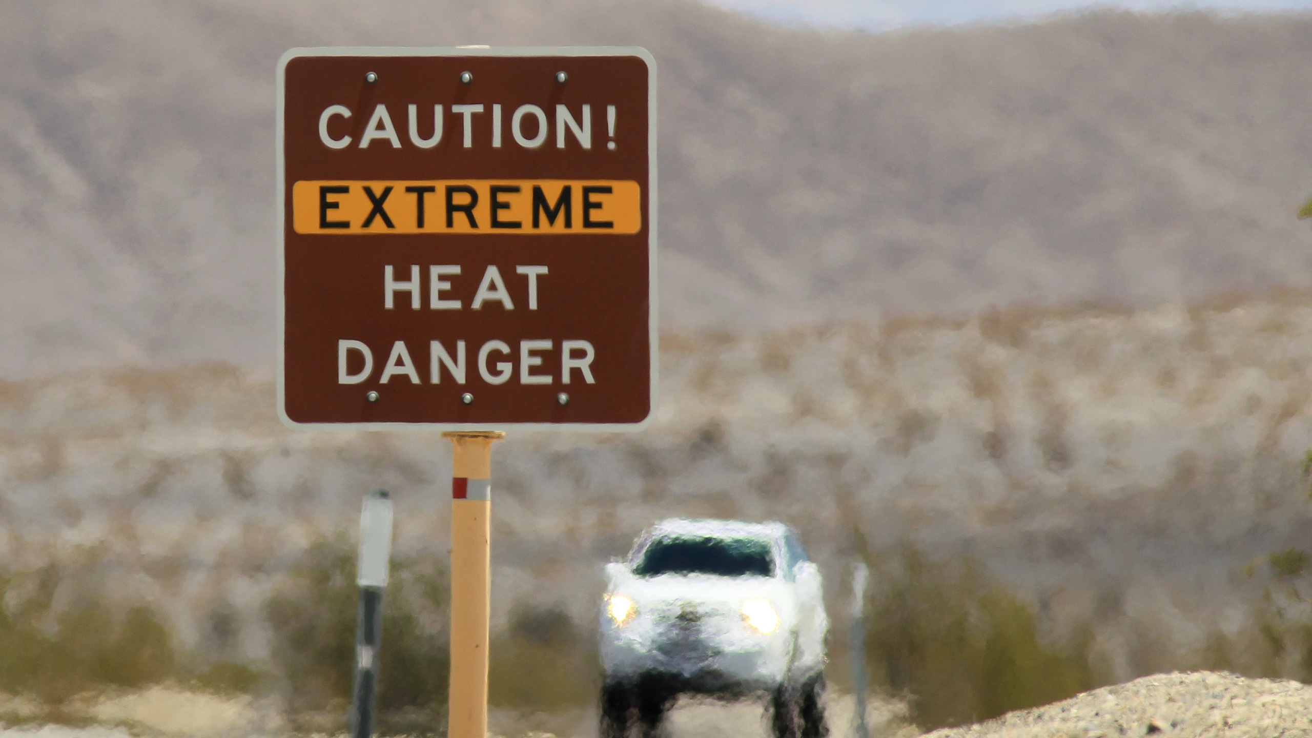 Heat waves rise near a heat danger warning sign on on July 14, 2013 in the Death Valley National Park. (Credit: David McNew/Getty Images)