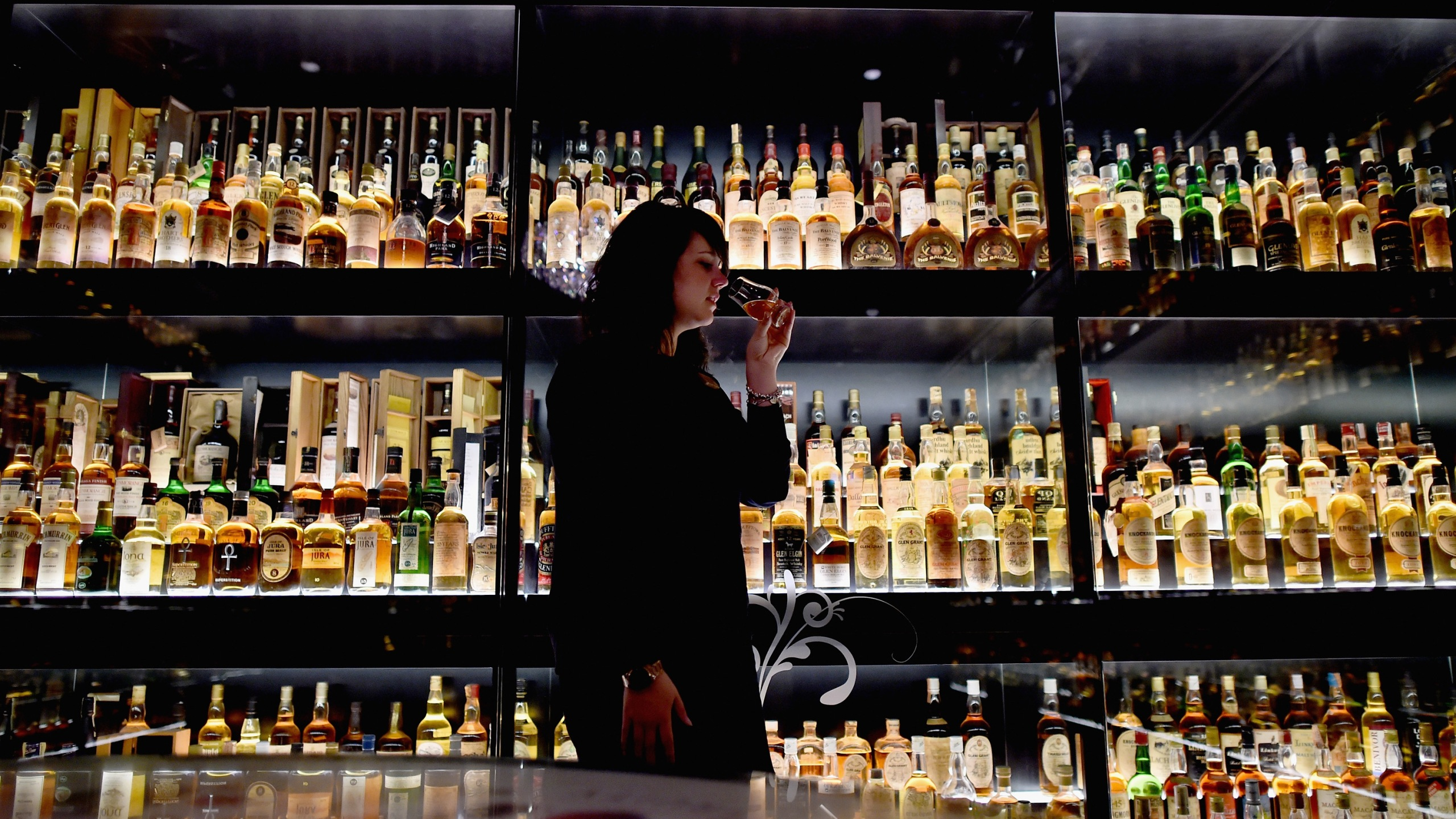 Members of the public examine whisky samples inside the Diageo Claive Vidiz Collection, the world's largest collection of Scottish Whisky, on display at The Scotch Whisky Experience on Sept. 3, 2015, in Edinburgh. (Credit: Jeff J. Mitchell / Getty Images)
