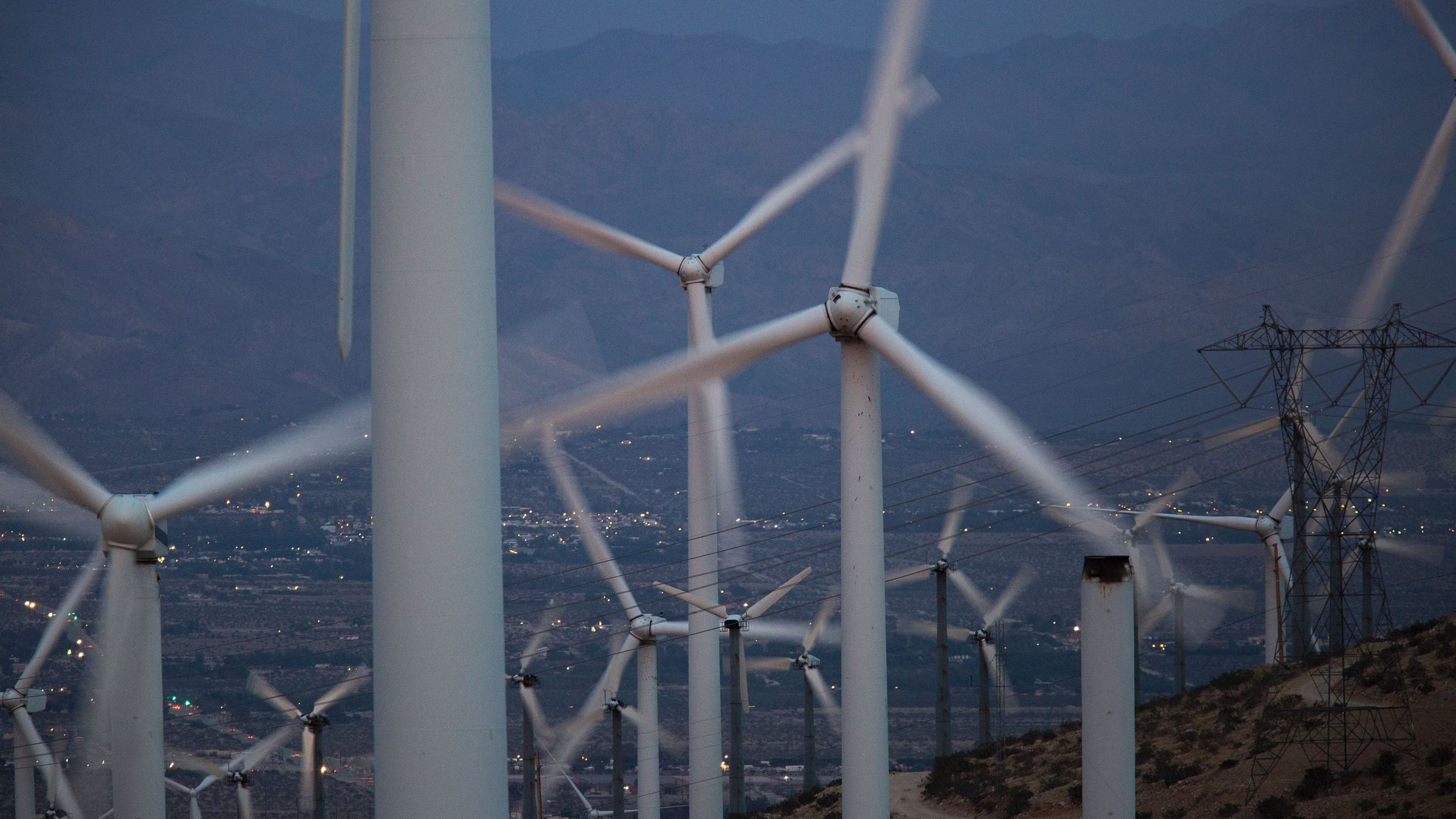Electric energy generating wind turbines are seen on a wind farm in the San Gorgonio Pass area near Palm Springs on April 22, 2016. (Credit: David McNew / AFP / Getty Images)