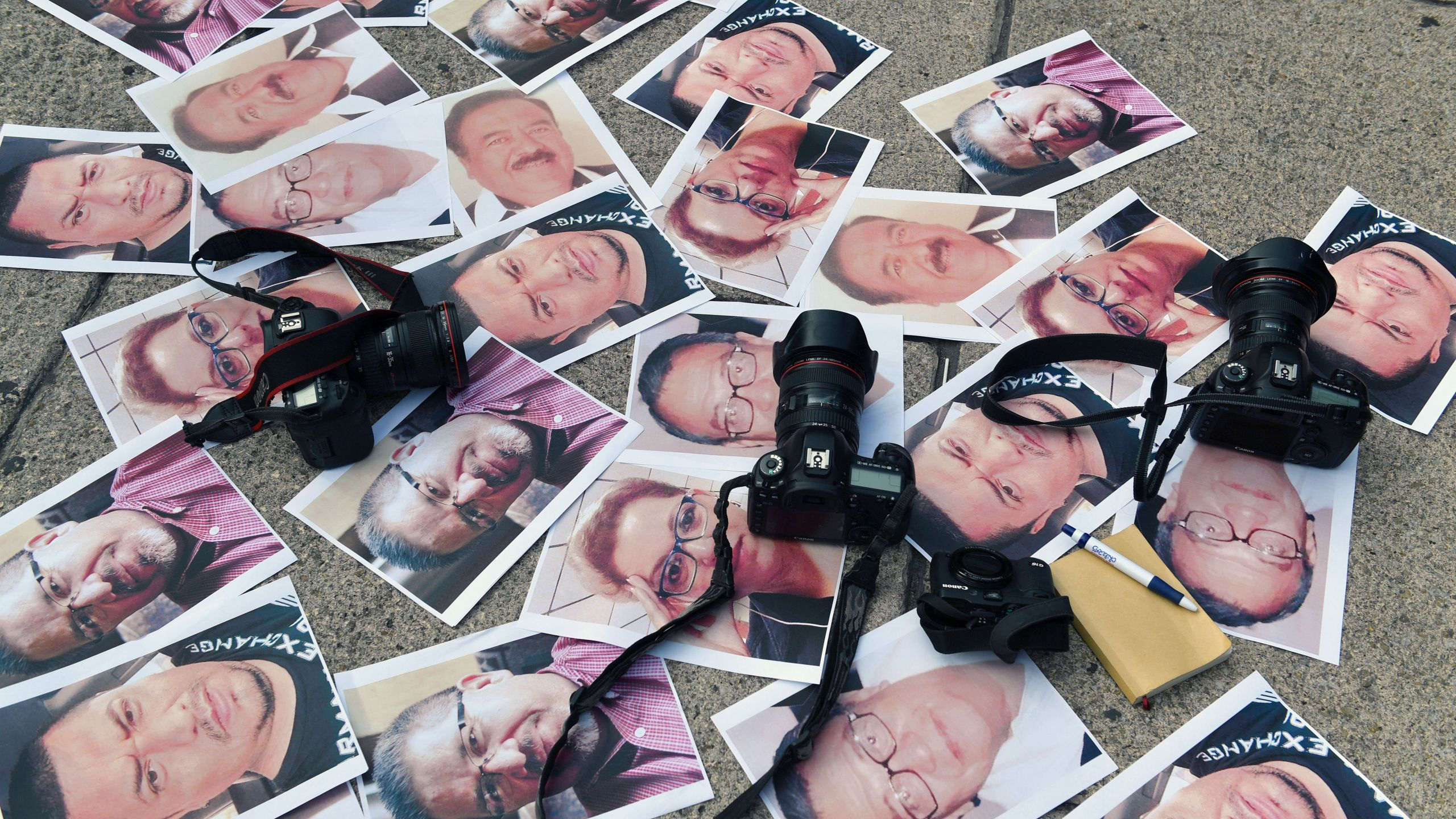 Cameras and pictures of journalists recently murdered in different Mexican states are placed at Independence Angel square in Mexico City during a protest on May 16, 2017. (Credit: Yuri Cortez / AFP / Getty Images)