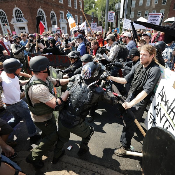 "White nationalists, neo-Nazis and members of the ""alt-right"" clash with counter-protesters as they enter Emancipation Park during the ""Unite the Right"" rally in Charlottesville, Virginia on Aug. 12, 2017. (Credit: Chip Somodevilla/Getty Images)"