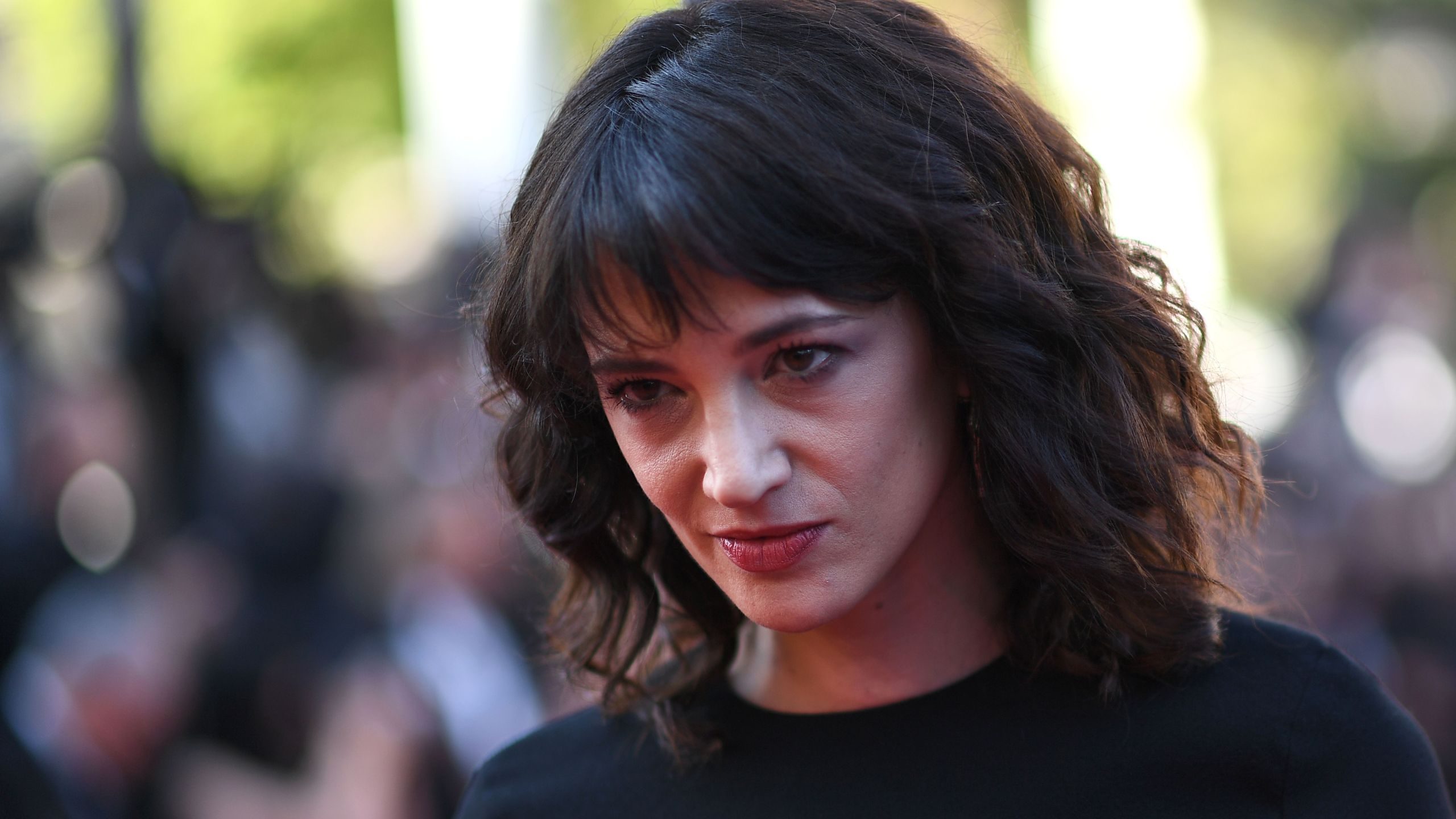 """Asia Argento poses as she arrives on May 19, 2018 for the closing ceremony and the screening of the film """"The Man Who Killed Don Quixote"""" at the 71st edition of the Cannes Film Festival in Cannes, France. (Credit: ANNE-CHRISTINE POUJOULAT/AFP/Getty Images)"""