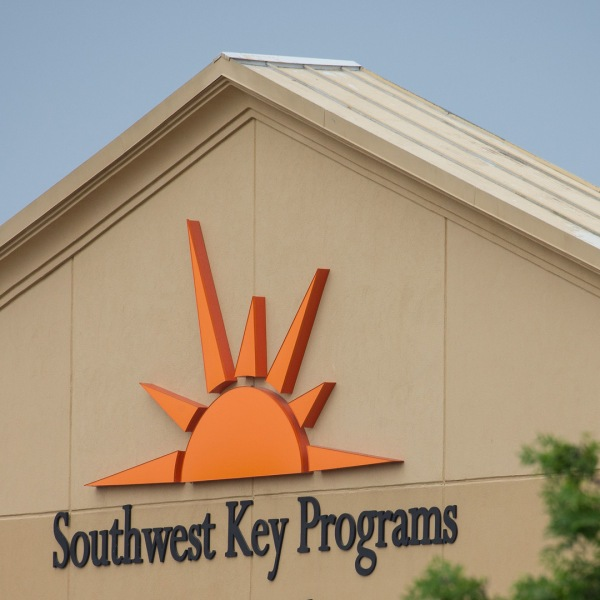 A sign for Southwest Key is seen at a former Walmart Supercenter now being used as a migrant children's shelter on June 18, 2018 in Brownsville, Texas. (Credit: LOREN ELLIOTT/AFP/Getty Images)