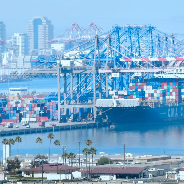 Containers are loaded onto shipping vessels from CMA CGM, the French container and transportation company, at the Port of Long Beach on July 6, 2018. (Credit: FREDERIC J. BROWN/AFP/Getty Images)