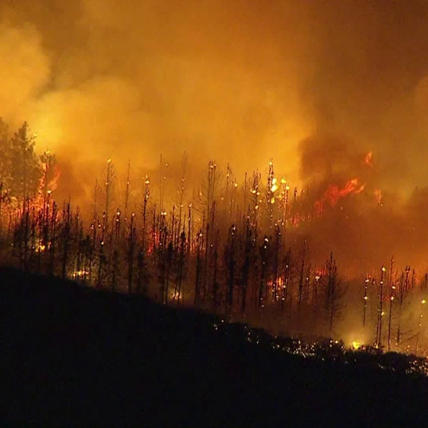 The Holy Fire scorches land in the Cleveland National Forest as it burns near Lake Elsinore on Aug. 7, 2018. (Credit: KTLA)