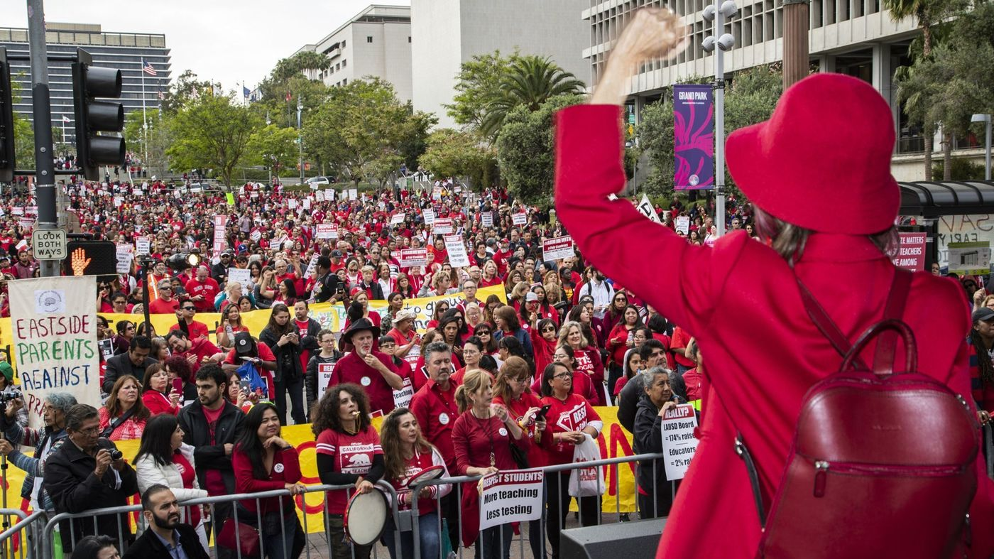 Thousands of teachers from the L.A. area fill Grand Park in downtown Los Angeles in late May 2018, attending a rally for better pay and working conditions.(Credit: Gina Ferazzi / Los Angeles Times)