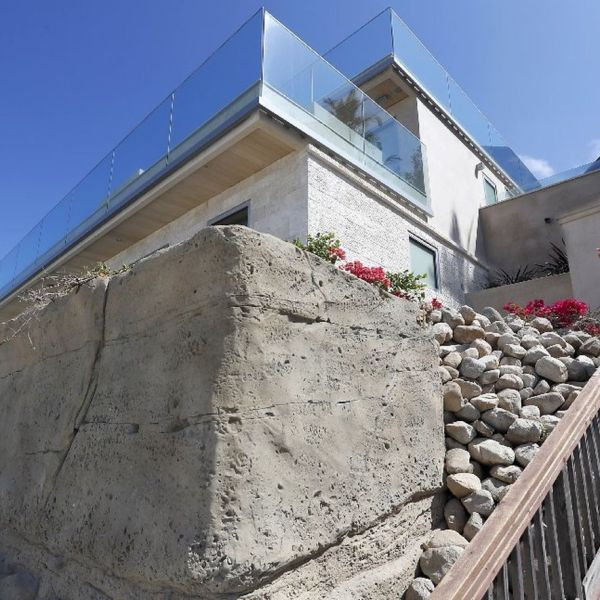 A sea wall protecting a multimillion-dollar home from erosion and crashing waves at Victoria Beach is seen in this undated photo. (Credit: Luis Sinco / Los Angeles Times)