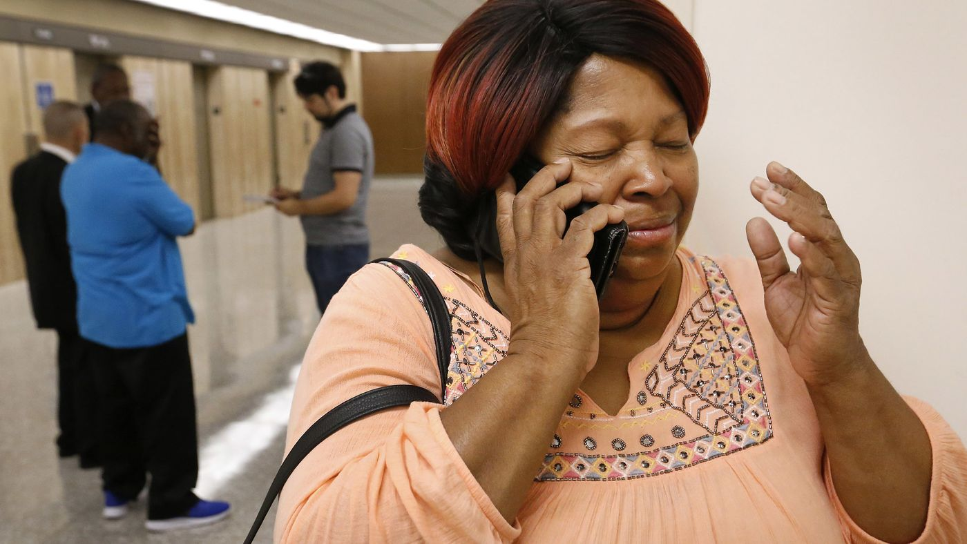 """Rosie Harmon, a sister of Bobby Joe Maxwell, the accused """"Skid Row Stabber"""" serial killer, is in tears as she calls their 84-year-old mother after a judge dismissed the charges against her brother, ending a 40-year legal odyssey on Aug. 10, 2018. (Credit: Al Seib / Los Angeles Times)"""