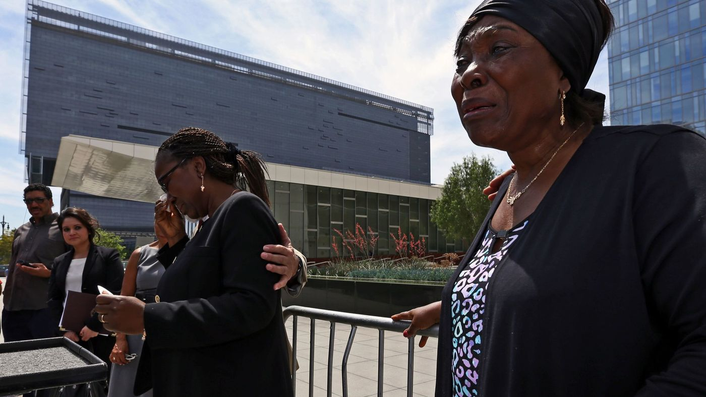 Heleine Tchayou, right, mother of Charly Leundeu Keunang, a homeless man shot and killed by LAPD on skid row, weeps as Keunang's sister Line Marquise Foming addresses a news conference about the family's lawsuit in 2016. (Credit: Irfan Khan / Los Angeles Times)
