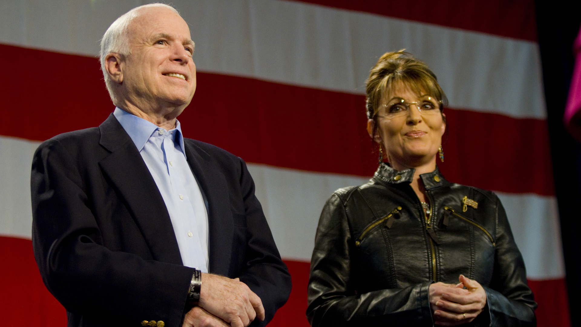 Sen. John McCain and former Alaska Gov. Sarah Palin attend a campaign rally at Pima County Fairgrounds on March 26, 2010 in Tucson, Arizona. (Credit: Darren Hauck/Getty Images)